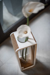 To Be: Cardboard and vase. The To Be line is a fantastic line of decorative vases inspired by the concept of design using modular elements, which are common to the entire Ecodesign collection. Through the crystal clear glass of every object a message is sent to you. To Be is a statement and reminds us through the showing of the roots of the plants or the flower stem, that every show has a «behind the scenes» that requires commitment and care. The essential lines are the result of the combination of simple components in various shapes and sizes. Made up of a glass part and a part available in various other materials such as cardboard, wood, methacrylate, aluminum, carbon, bioplastic ecc. each TO BE vase can be brought back to life, just by the replacement damaged parts.